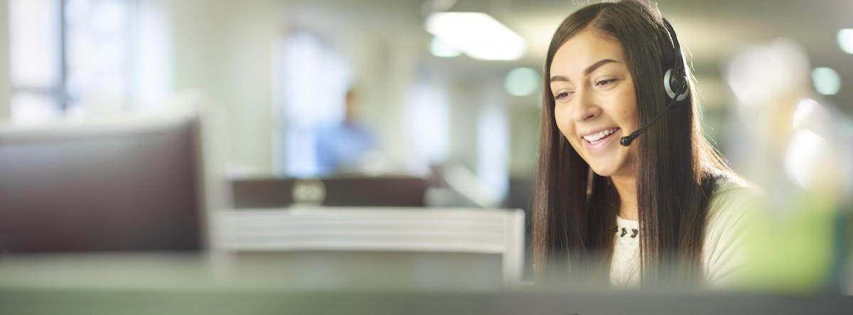 a young female call centre worker takes a call.